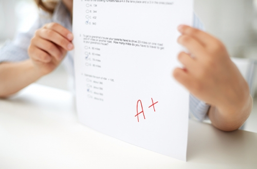 girl-with-test-paper-at-school-pdhmeu7